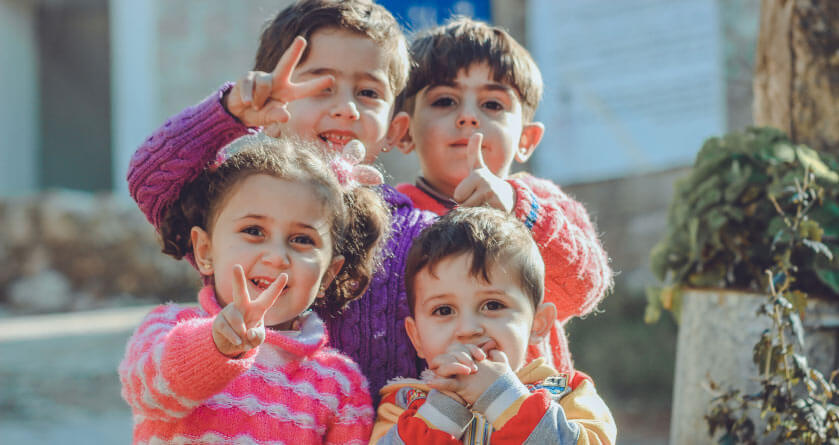 four young kids posing