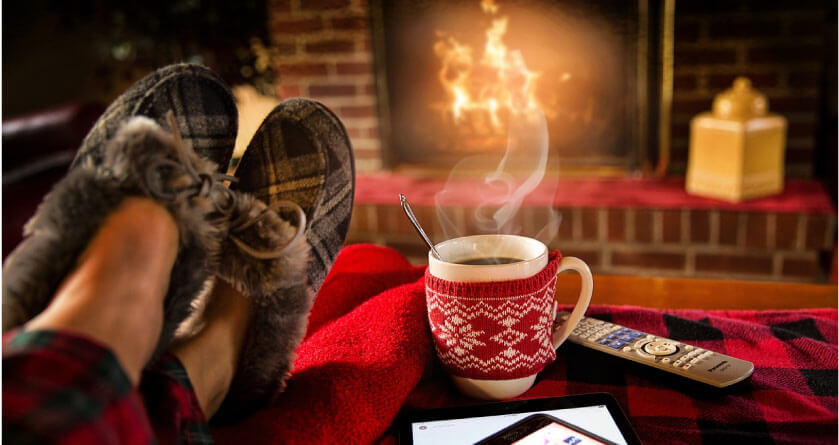 relaxing in slippers with a hot drink in front of the fire after oral surgery
