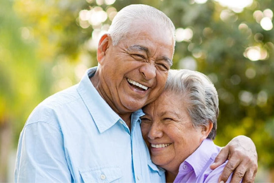 senior couple hug and smile after learning about the versatility